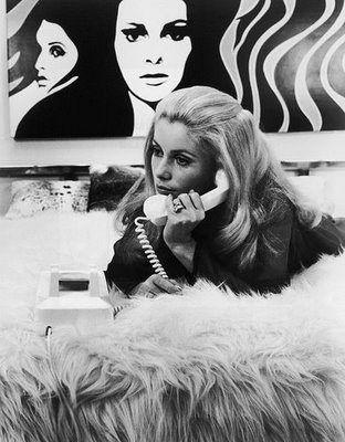 "Channelling: ""Allo dahling."" Recline on the bed with your Deneuve tresses and cat eyes"
