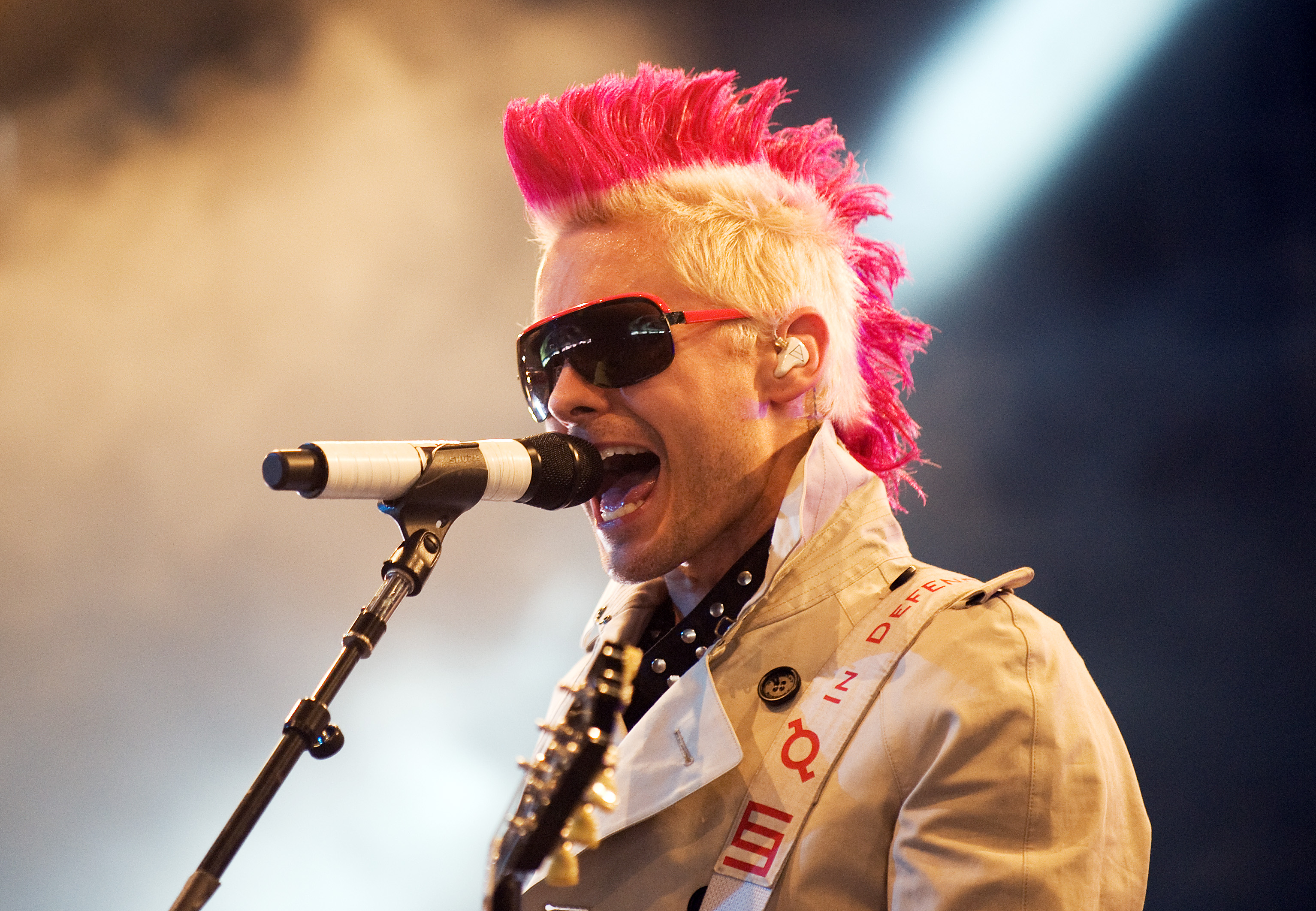 Not long ago, Jared had a pink Mohawk. Here he is performing in Wales with 30 Second to Mars.