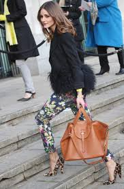 Olivia Palermo shows us how its done matching her black fur-trimmed jacket, printed floral pants and leopard pumps.