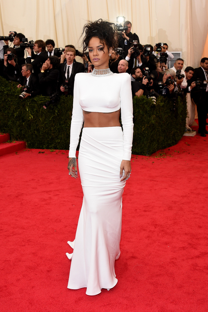 Rihanna shows off her enviable abs in a white Stella McCartney ensemble.