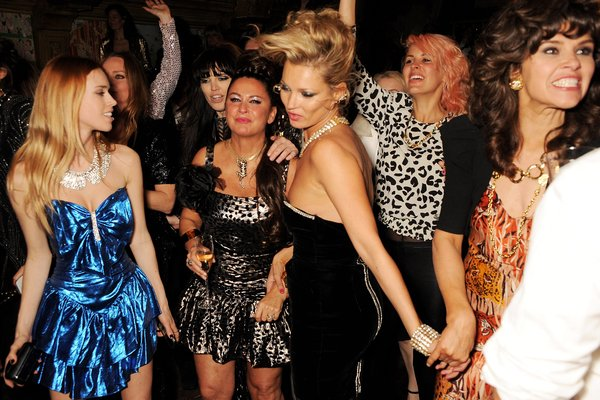 You make me feel like dancing: Kate lets her hair down at Fran Cutler's bday in London. It's an 80's Dynasty theme.