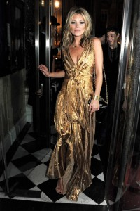 Celebrating her book signing in a sultry gold Marc Jacobs dress