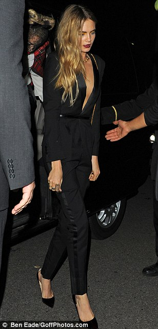 Night Moves: Cara sports a tuxedo inspired jumpsuit. This is a polished look for evening. Very Helmut Newton, non?